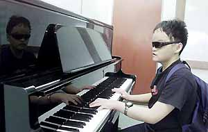 Colin Ng with his Piano